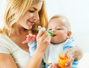 Mom feeding baby homemade baby food puree